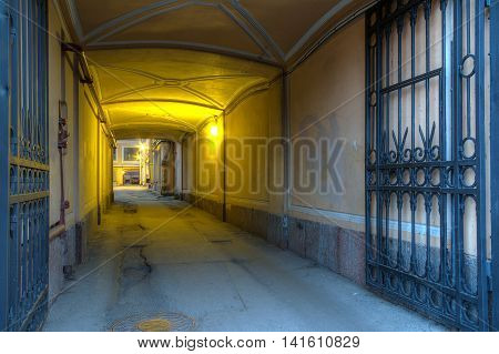 Illuminated arch in old urban office building in St. Petersburg Russia