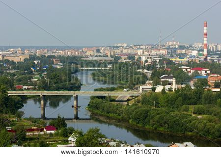 Beautiful cityscape of small town with river and bridge in summer
