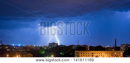 night thunderstorm over the buildings in the city