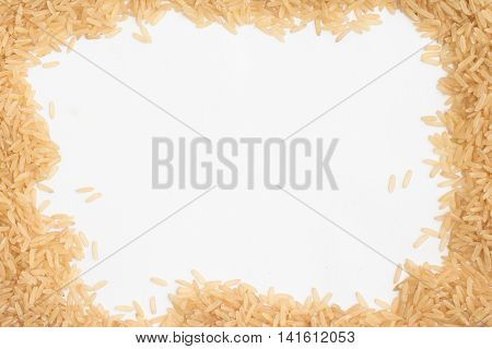 Raw Bown rice frame in white background
