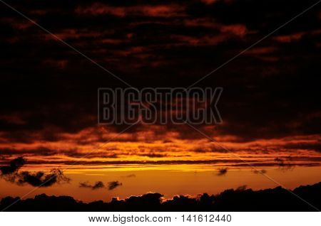 Orange Sky With Heavy Dark Clouds