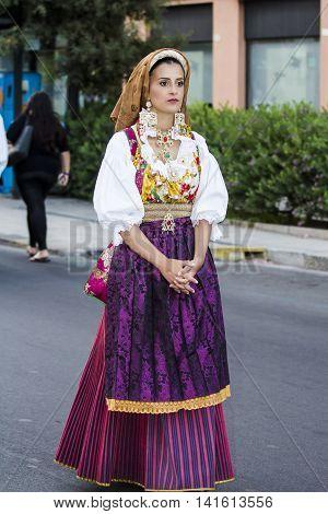 QUARTU S.E. ITALY - July 15 2016: 30 ^ Sciampitta - International festival of folklore - Sardinia - portrait of a beautiful girl in traditional Sardinian costume