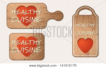 Wooden breadboard with the words healthy cuisine
