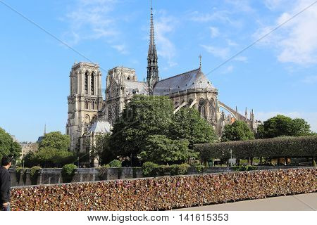 PARIS, FRANCE - MAY 13, 2015: This is a view of Notre Dame de Paris with Arsheveshe bridge.