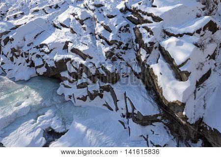 Interesting view on frozen cliffs of Carpathians in Bukovel Ukraine