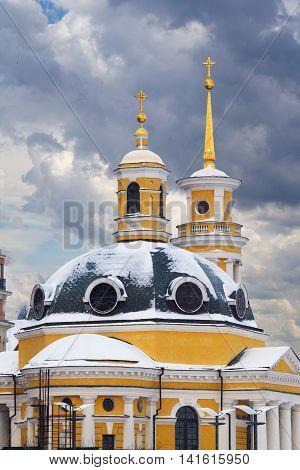 Yellow domes of Kiev Church of Nativity at Pochtovaya square Ukraine