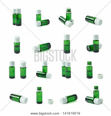 Small green glass flask vial, composition isolated over the white background, set of multiple different foreshortenings