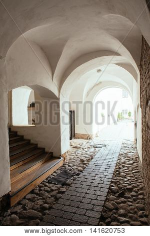 An arched passageway in the courtyard of the old town in Vilnius