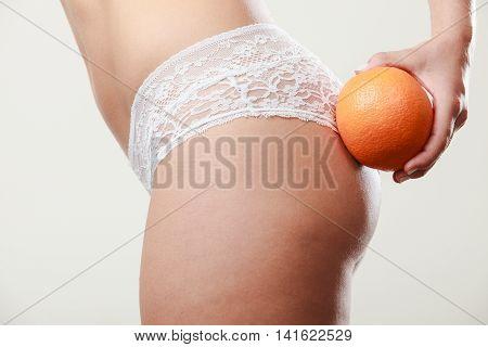Girl Holding Orange Next To Bottom