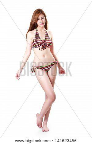 Pretty swimsuit fashion young asian woman posing Isolated over white