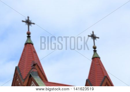 Red Catholic church of St. Simon and St. Helena in Minsk, Belarus, defocused