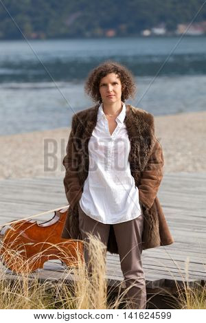portrait of beautiful girl on the seashore, outdoors