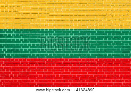 Flag of Lithuania on brick wall texture background. Lithuanian national flag.