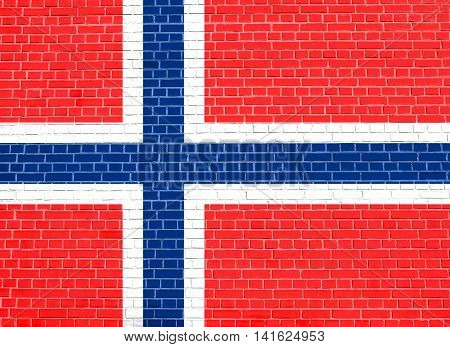 Flag of Norway on brick wall texture background. Norwegian national flag.
