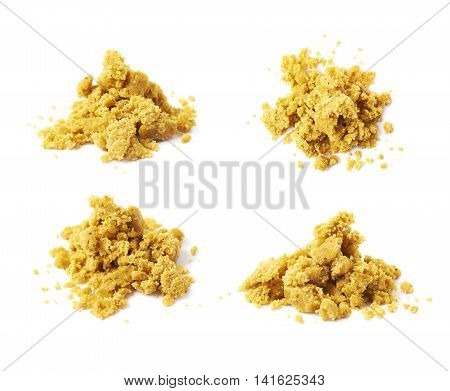 Crushed yellow bouillon stock broth cube isolated over the white background, set of four different foreshortenings