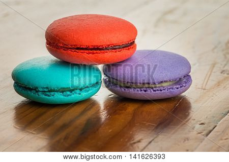 colorful macaroons on a vintage wooden table