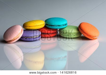 Assorted colors of macaroons on neutral background