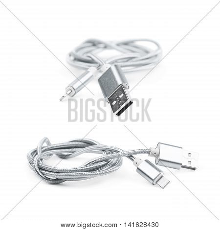 Folded USB lightning silver metal cable isolated over the white background, set of two different foreshortenings