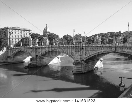 ROME, ITALY, MAY 26, 2013: black and white shot of the Ponte Sant'Angelo bridge, with shadows on the Tiber River, late afternoon