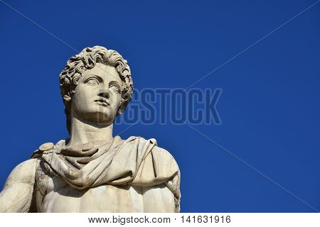 Castor or Pollux. Ancient marble statue of Dioskouri at the top of monumental balustrade in Capitoline Hill Rome (with copy space)