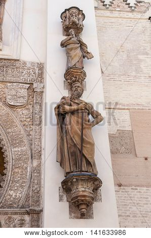 Statue of Saint Paul the Apostel by the Gate of Pardon of Seville Cathedral Spain