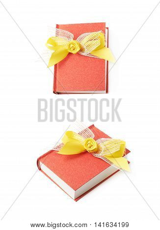 Red gift book with the yellow decorational bow over it, composition isolated over the white background, set of two different foreshortenings