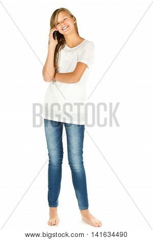 Young girl standing taking a call on a mobile phone over white background