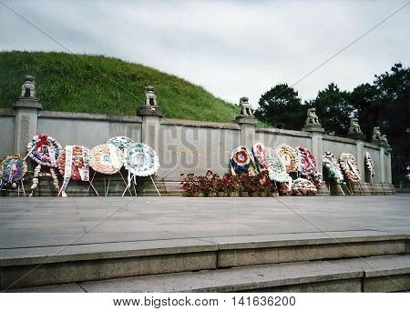 GUANGZHOU / CHINA - CIRCA 1987: Flowers and wreaths stand at the Tomb of 72 Martyrs of Huanghuagang