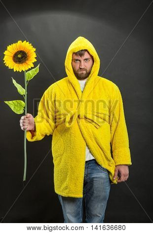 Man in the monitor holding a sunflower