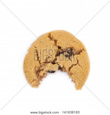Soft chewy chocolate chip cookie with a single bite taken of it, composition isolated over the white background