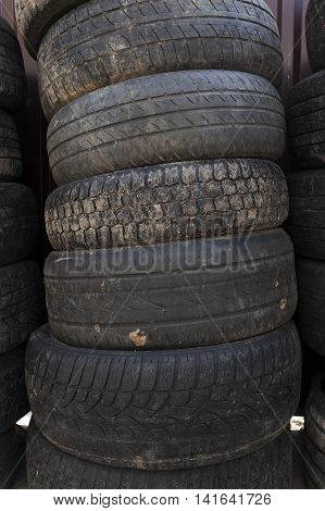 photographed close up Black used damaged tires. small depth of field