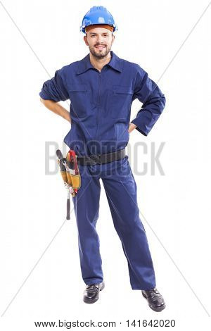 Young worker with tool belt, isolated on white background