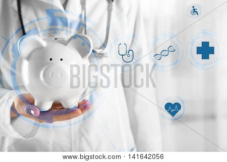 Doctor hands with piggy bank. Medical technology concept