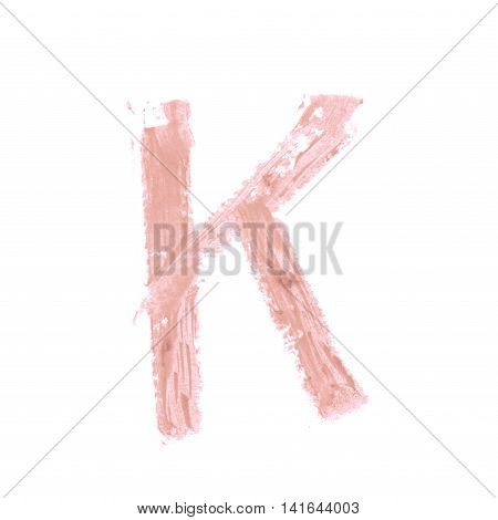 Single abc latin K letter symbol drawn with a wax crayon isolated over the white background