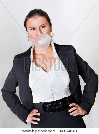 Businesswoman blowing bubblegum