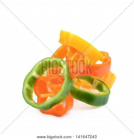 Colorful pile of green, orange, yellow bell pepper slices isolated over the white background