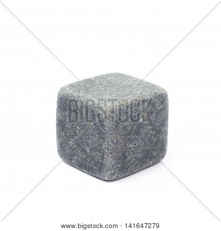 Single whiskey stone cube isolated over the white background