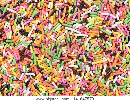 Closeup Colorful candy sprinkles background. Top view