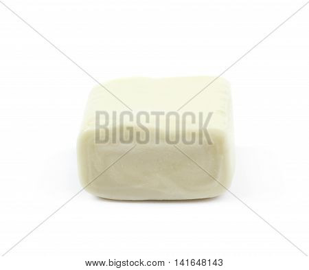 Chewing cuboid-shaped candy gum isolated over the white background