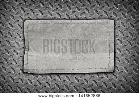 jeans labels on steel plate background for texture