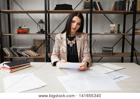 Successful business woman checking documentation. Paperwork, bureaucracy, documents inspection concept