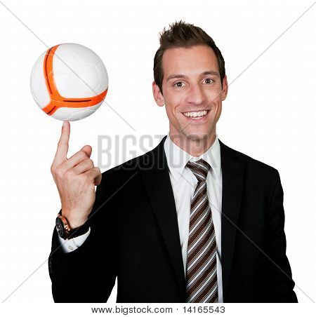 Businessman spinning soccer ball