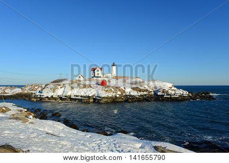 Cape Neddick Lighthouse (Nubble Lighthouse) at Old York Village in winter, Maine, USA.