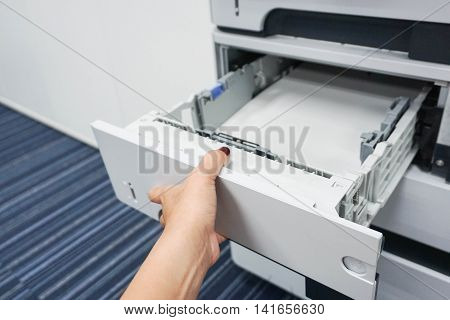 open the printer tray to put the paper
