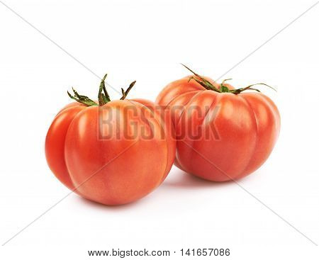 Composition of two ripe red beef tomato isolated over the white background
