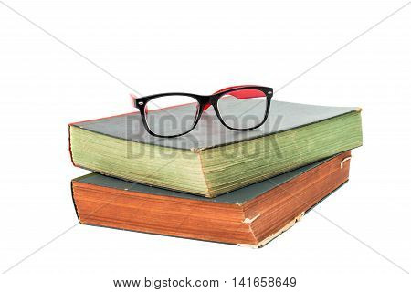 book encyclopedia with glasses on white background