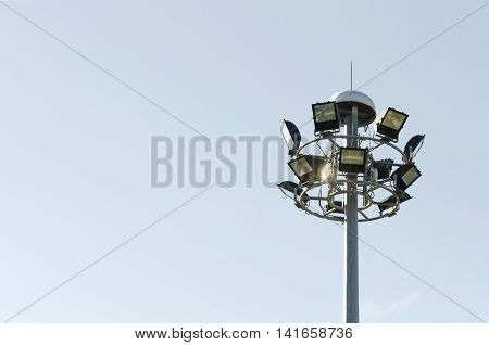 Pillar spotlights in a park high space sky