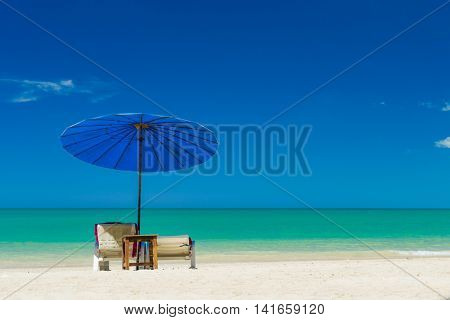 Umbrellas and sunbeds on the tropical  beach