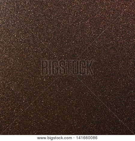 Close-up fragment of a brown teflon pan coating as a backdrop texture composition