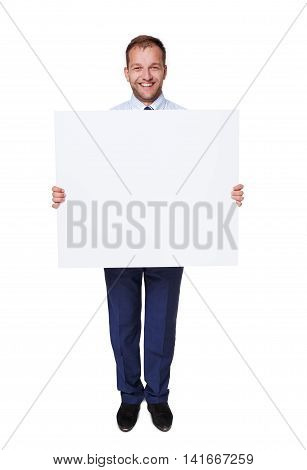 Businessman hold and show blank advertising board, isolated on white background. Big white poster in man's hands with copyspace.
